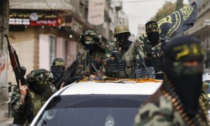 Islamic Jihad militants ride on a pickup truck as they follow the convoy of freed Palestinian prisoner Baroud, upon his arrival in the northern Gaza Strip